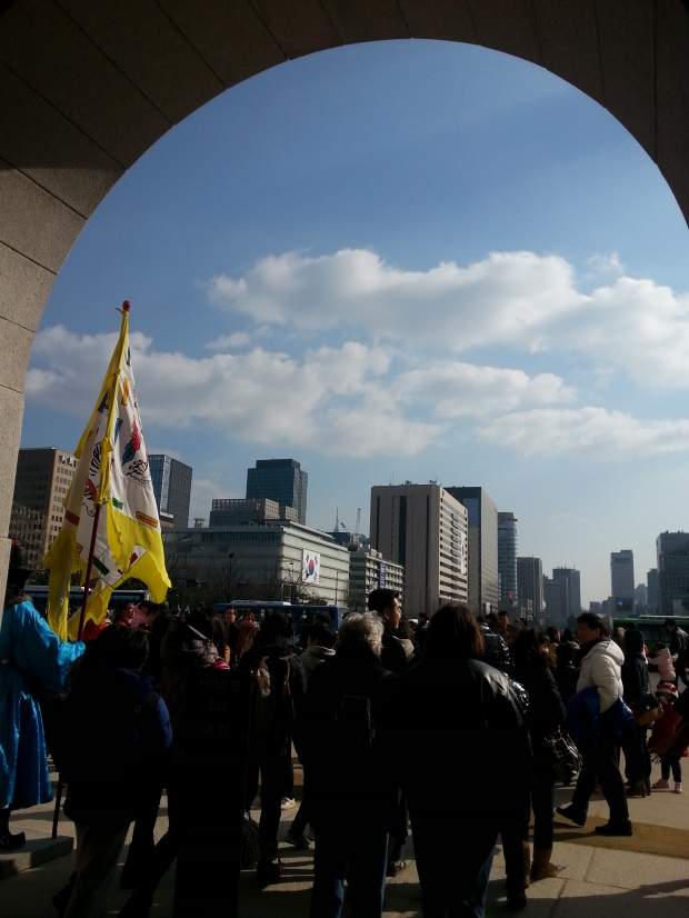 Under the Gwanghwamun archway, looking out at the square.